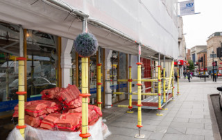 Public protection added to a Layher Allround scaffolding.
