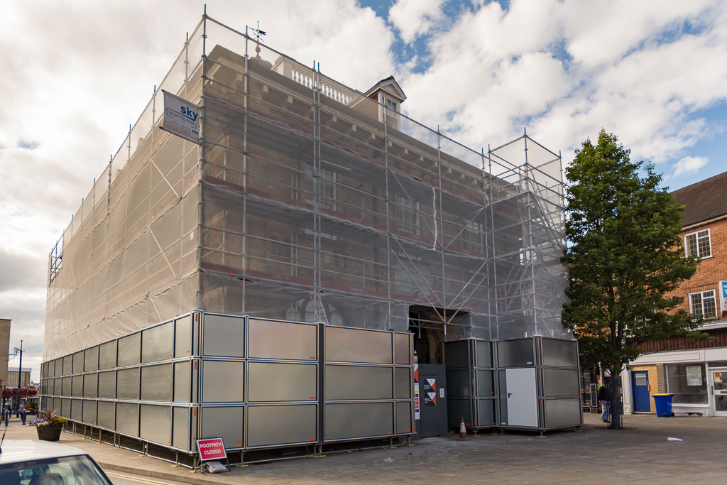 Completed scaffold with hoarding and debris netting.