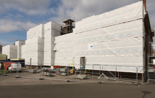 Fully sheeted front elevation using Layher Allround.
