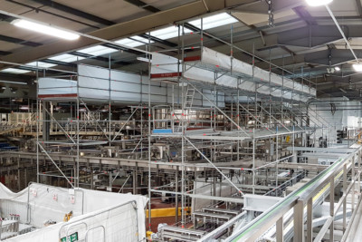 Industrial scaffolding solution to access high level lights in a factory provided by Sky